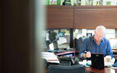 Brian O'Brien working at his desk