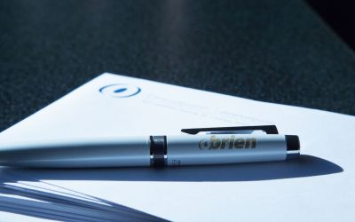 O'Brien pen sitting on top of a stack of O'Brien envelopes