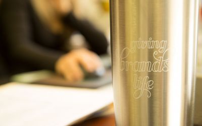 Close up of an O'Brien thermos with the O'Brien slogan Giving Brands Life
