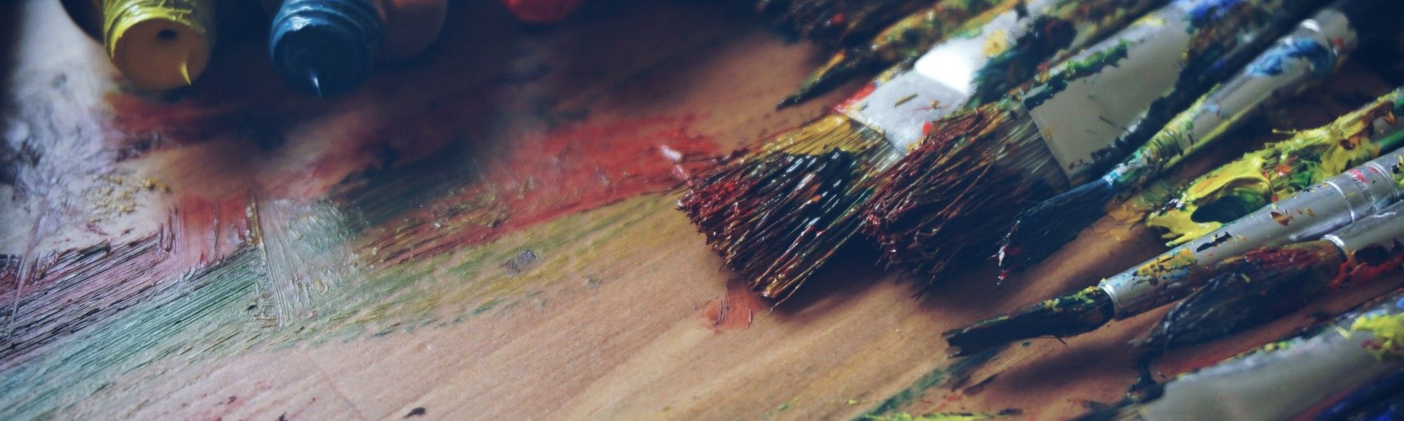 Dirty paint brushes with various colors